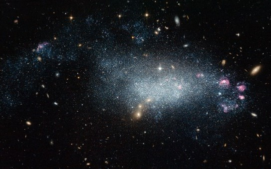 This image from the NASA/ESA Hubble Space Telescope shows a cosmic oddity, dwarf galaxy DDO 68. This ragged collection of stars and gas clouds looks at first glance like a recently-formed galaxy in our own cosmic neighbourhood. But, is it really as young as it looks?